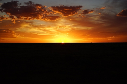 This is outback of Australia. Sun, horizon, crazy sky, full of drama